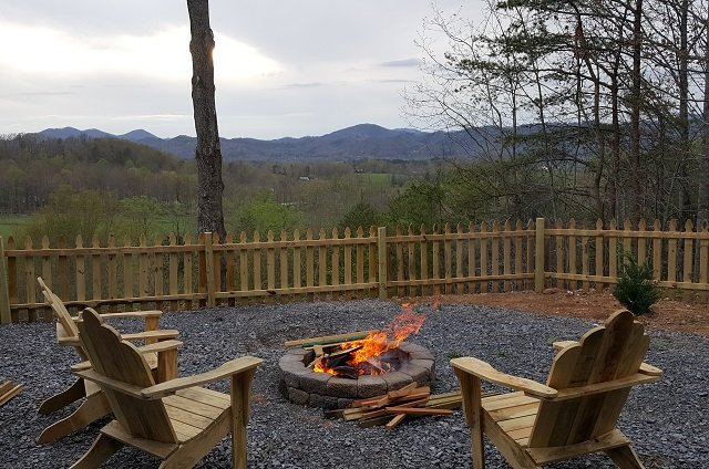 Custom fire pit - fenced yard - custom made chairs to enjoy star filled evenings -can it get better?