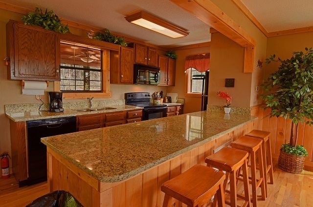 Granite counter tops - new appliances - breakfast bar and views view views from open floor plan!