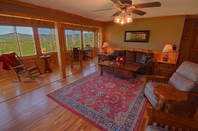 Big Living Room - custom furnishings - all windows to enjoy the views!