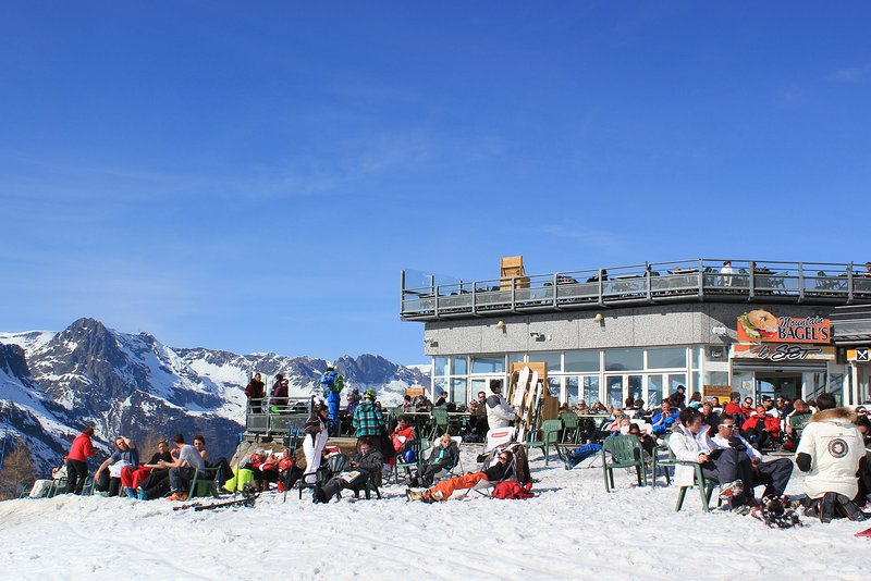 Ski holiday is not just for skiing - enjoy you drink sunbathing at the top of Lognan lift.