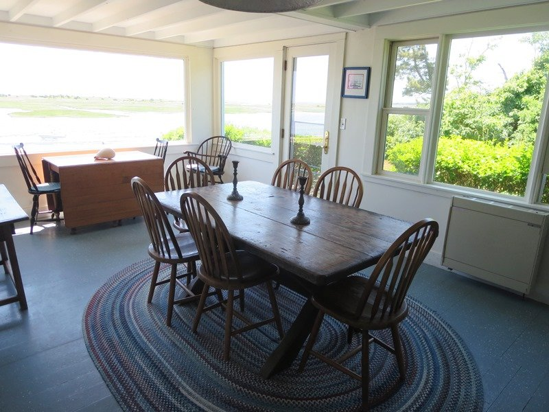The dining room is off of the kitchen and opens to living room. There are 2 tables so the family can all dine together! - 30 Seabeach Road Chatham Cape Cod New England Vacation Rentals