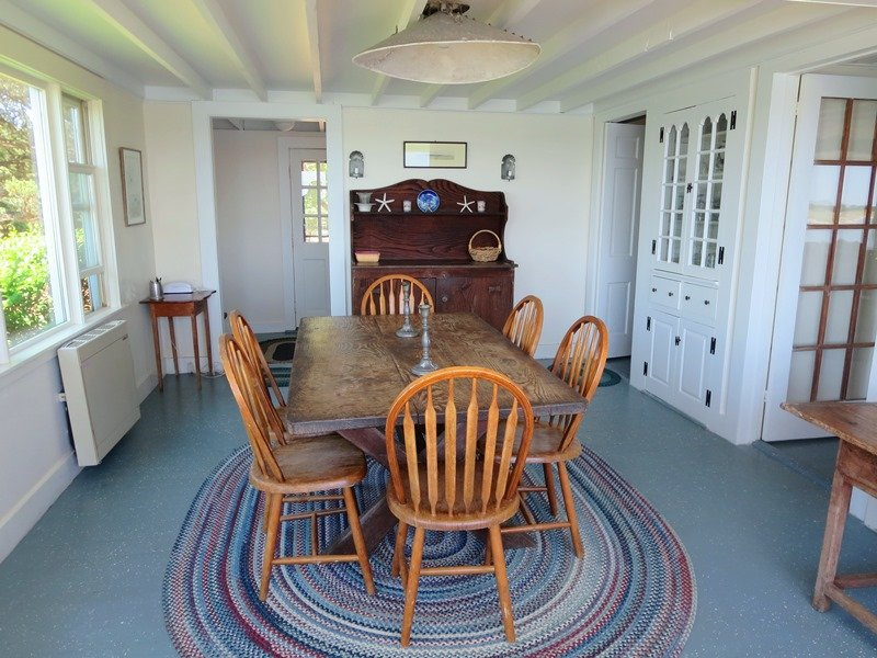 The dining room with the kitchen and living room off to the right - 30 Seabeach Road Chatham Cape Cod New England Vacation Rentals