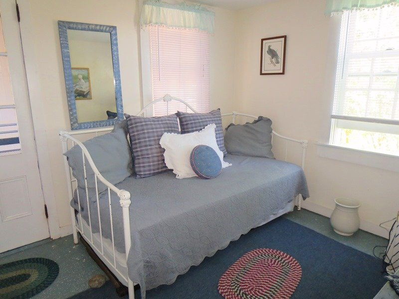 Bedroom 3 with a trundle bed (2 Twins) on the 1st floor. This room offers  access outside to outdoor shower - 30 Seabeach Road Chatham Cape Cod New England Vacation Rentals