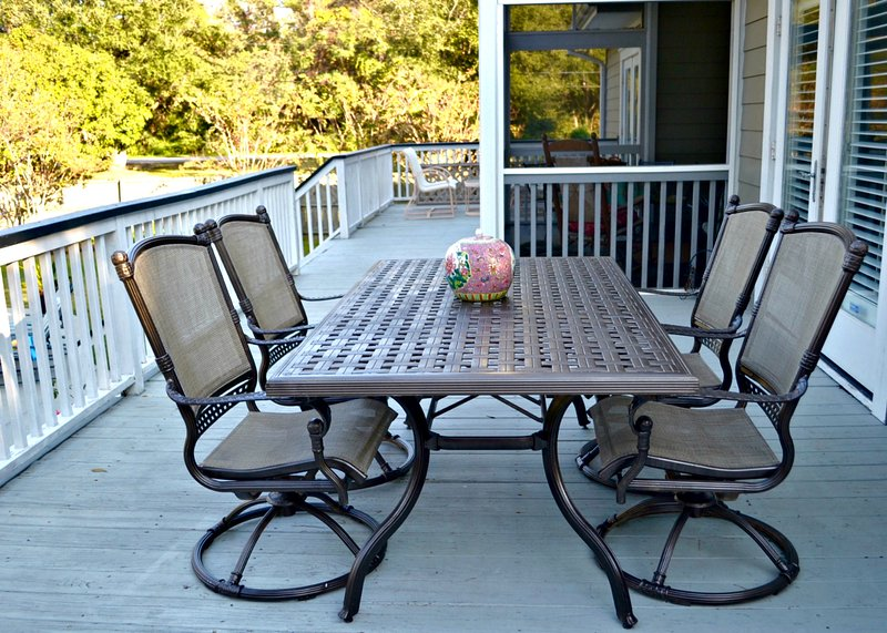Outdoor dining on deck. Second outdoor table is in the screened porch.