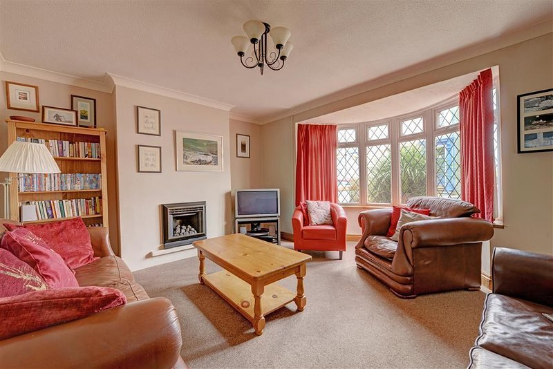 Spacious lounge with large bay window