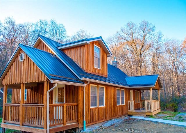 Beautiful rough cut wood and metal roofing adorns the outside of