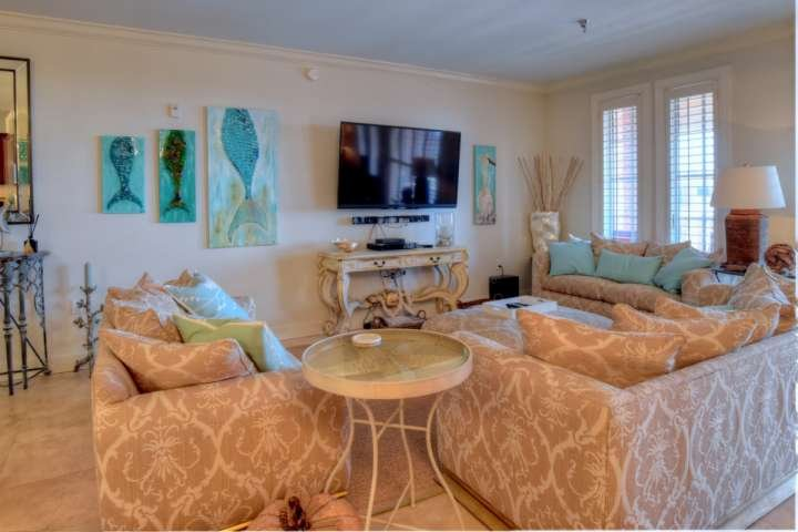 Living Room features plenty of seating and a huge flatscreen tv, making it a perfect place for the whole family to relax!