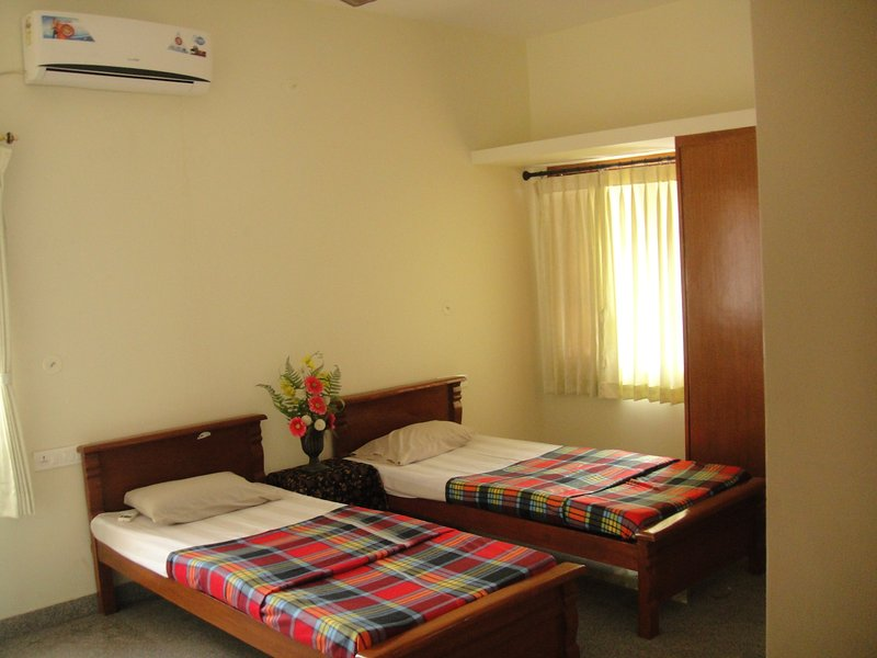 Double bedroom with split ac ,wardrobes and attached bathroom toilet.