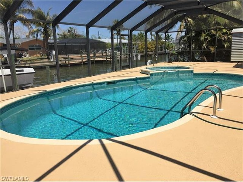 Heated pool and hot tub!  Beautiful views of deep-water canal.