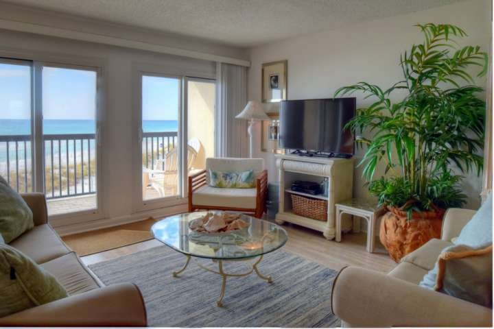 Beautiful Living Room Area with Plenty of Comfortable Seating - Access to Balcony and Views of the Emerald Waters of the Gulf of Mexico