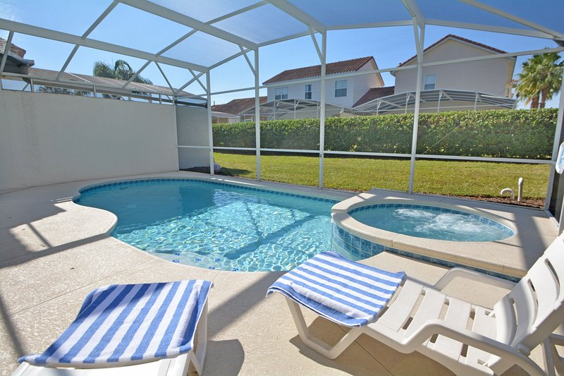 Pool jacuzzi and sun loungers