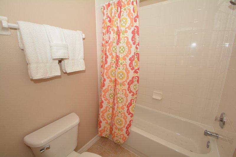 Family bathroom showing bath