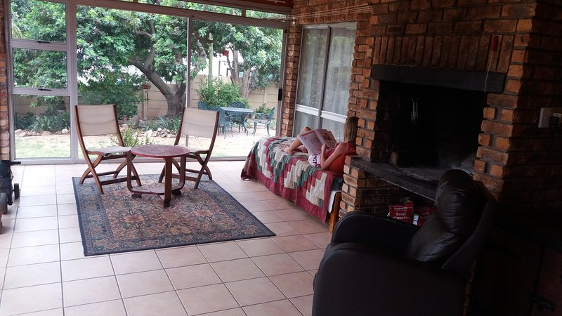 Indoor sitting area and barbeque on balcony