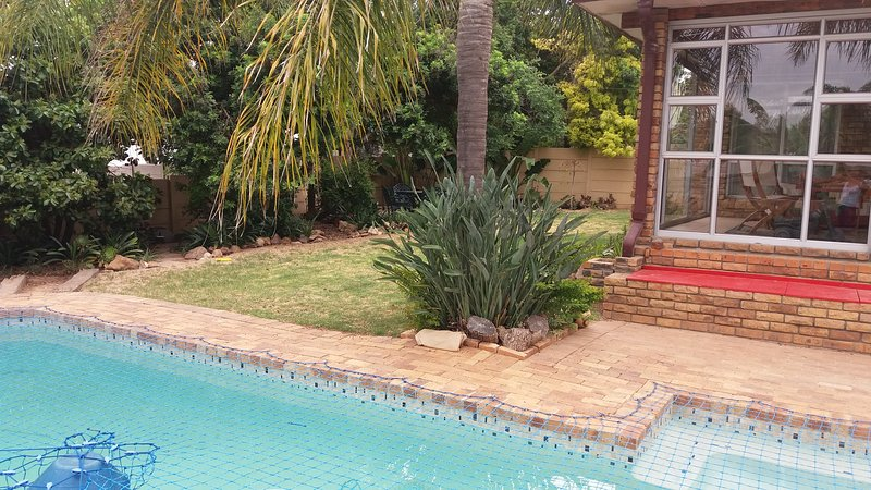 Swimming pool with outdoor sitting area