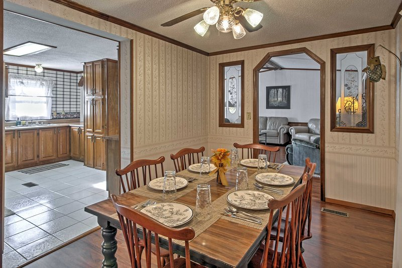 Gather around the lovely dining table to savor every bite of your tasty homecooked meal.