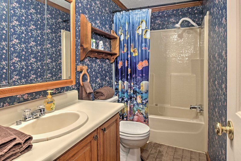 Freshen up for the day in this clean bathroom.