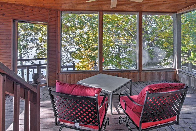 Marvel at nature's beauty from the screened-in porch.