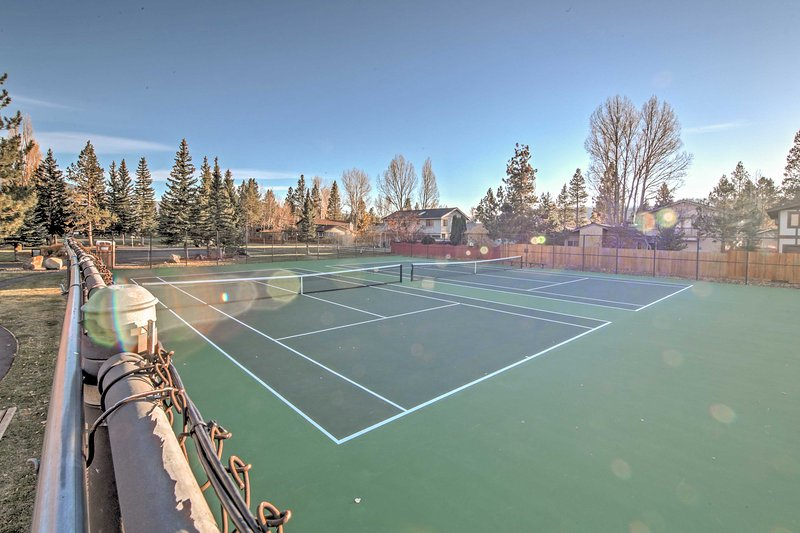 Challenge your travel companions to a tennis match on the community courts.
