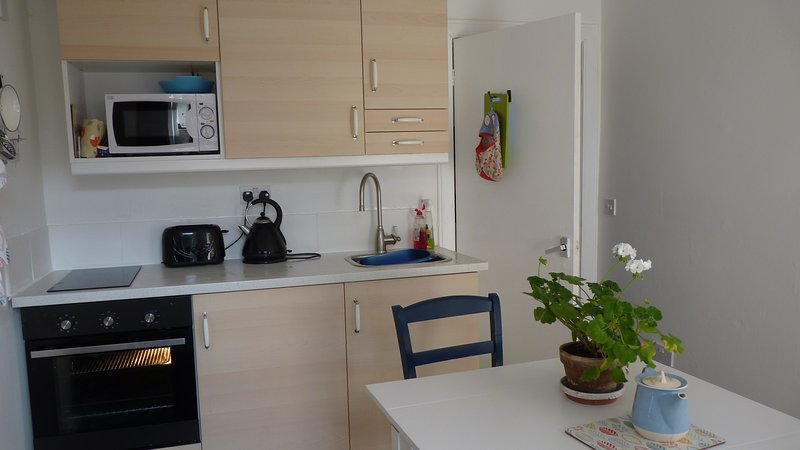 The kitchen has a fridge, freezer box, oven, two ring hob and microwave.
