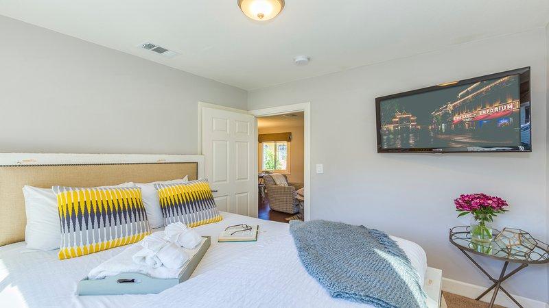 Bedroom 1: Queen bed.