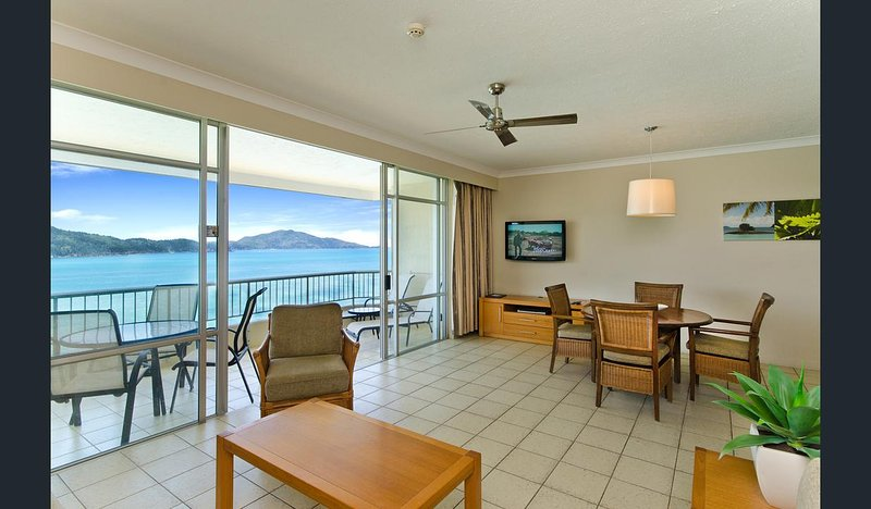 Large open-plan living and dining area, with views of the beach, islands and reef from the top floor