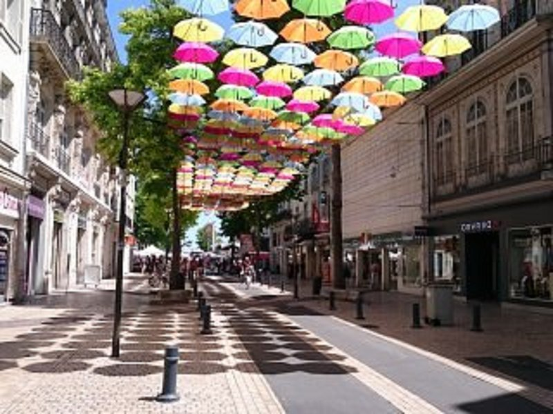 Saumur main shopping road - the umbrellas are for shade rather than rain here!