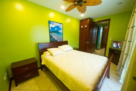 Guest room with queen bed, a/c and cable tv.