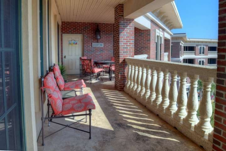 Enjoy brunch on the oversized balcony overlooking the Courtyard at The Villages of South Walton