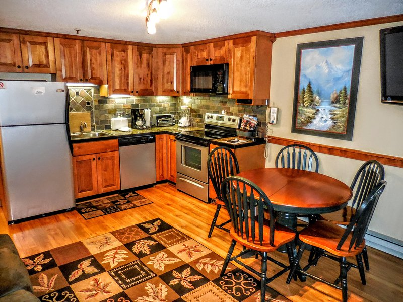 Tastefully remodeled with hardwood floors, marble counter, and solid wood finishes.