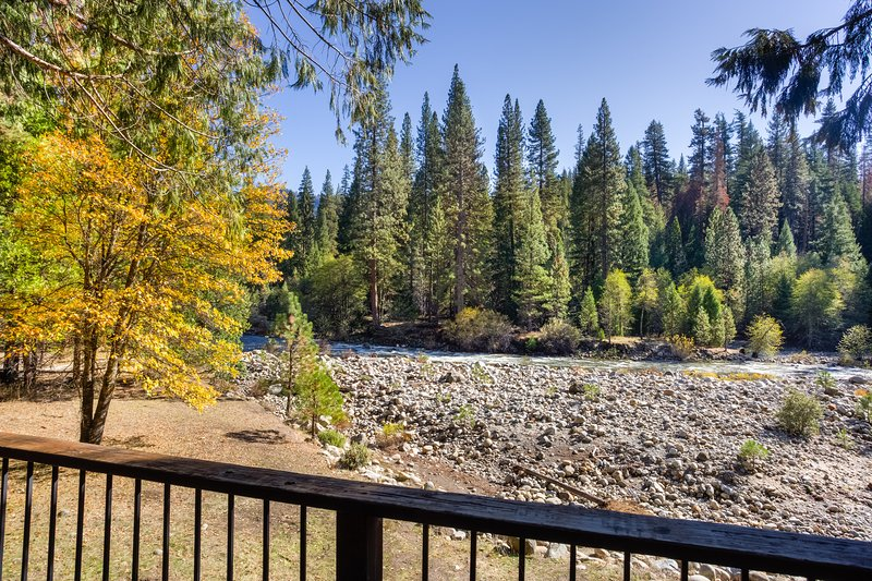 The South Fork of the Merced River which can be seen from the cabin deck.