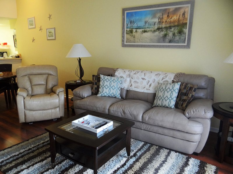 Beautiful living room with NEW furniture and flooring.