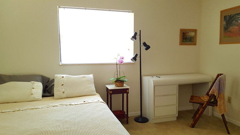 Comfortable Queen Room with Full Bath located minutes from the beach with full amenities and more...