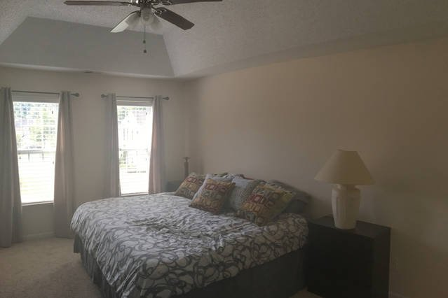 master bedroom with queen bed and full bath with garden tub and separate shower