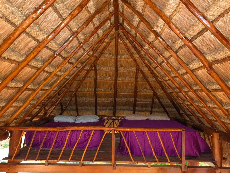 Loft in rooftop palapa can be configured for 1 queen, 2 queens, or lounge style