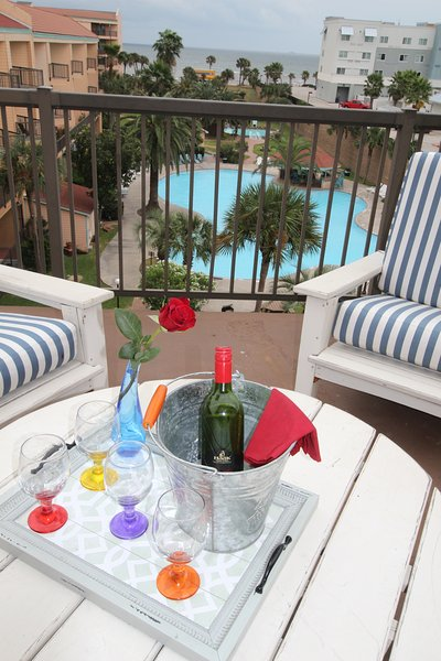 Sit back, relax with a cool drink and enjoy this fantastic view of the Gulf and lagoon pool!