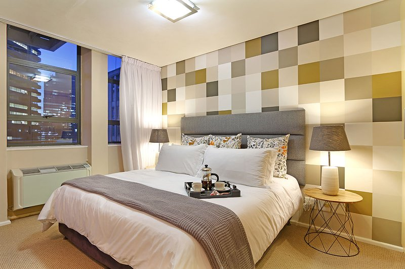 Queen size bed with a feature wall