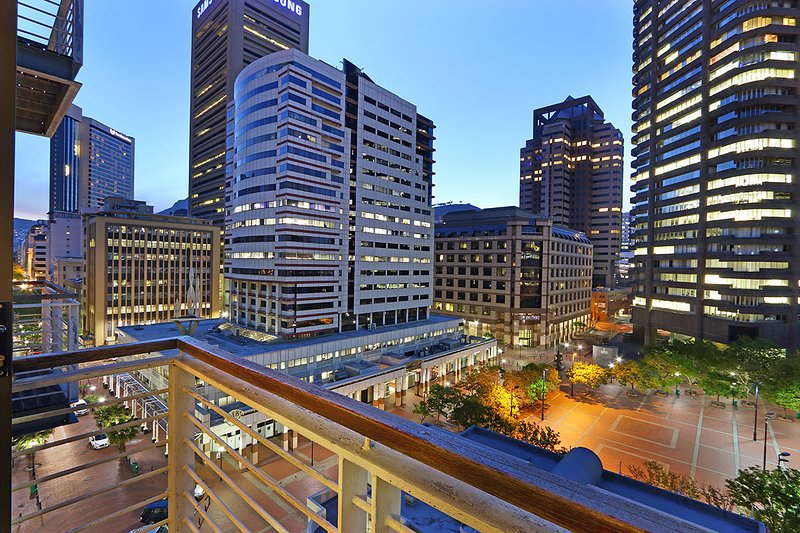 Balcony view shows the Fountains Square and city buildings
