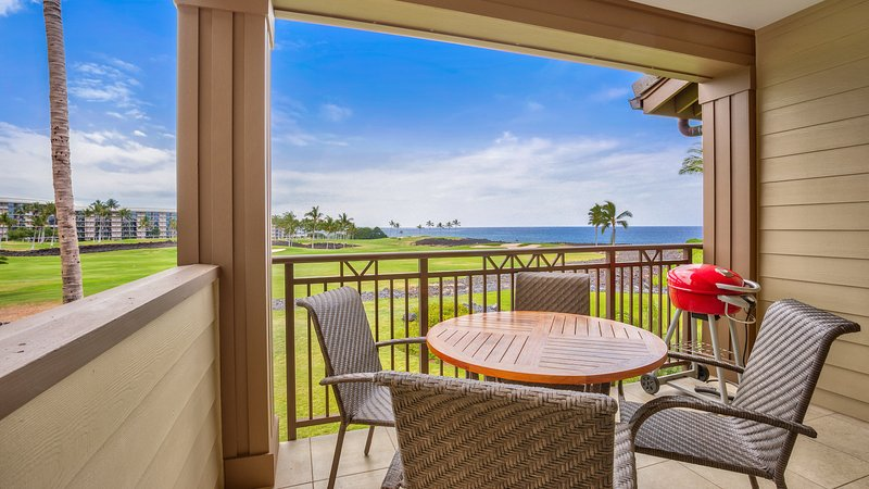 Spacious lanai with ocean, coastline, golf course, and sunset views.