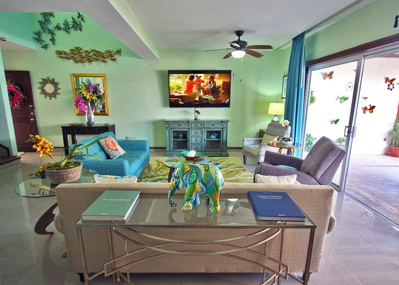 Living room with 70 inch HDTV with US Dish Network, Dose Speakers