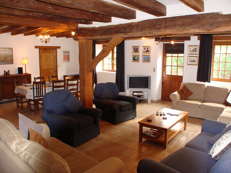 Comfortable living area with plenty of seating and UK TV.