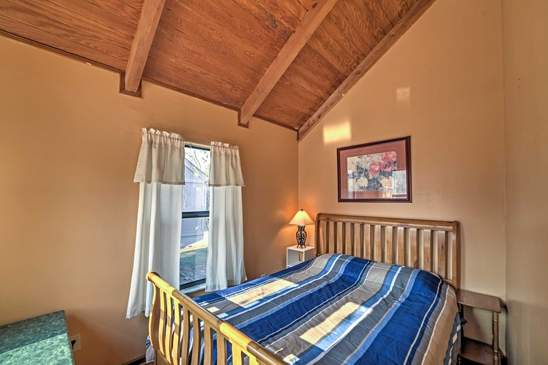 Look forward to a rejuvenating sleep on either of the cabin's comfy full-sized beds.