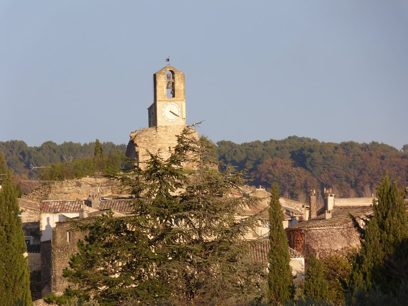 The belfry of Lourmarin seen from the field casteuse