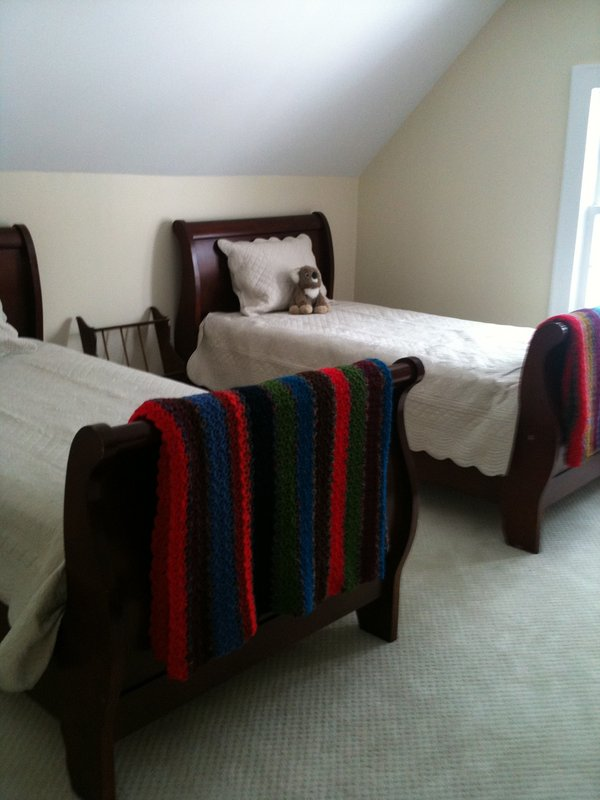 TWIN SLEIGH BEDS  AND ANOTHER SINGLE BED WITH WINDOWS ON NORTH SIDE. 3rd FLOOR.