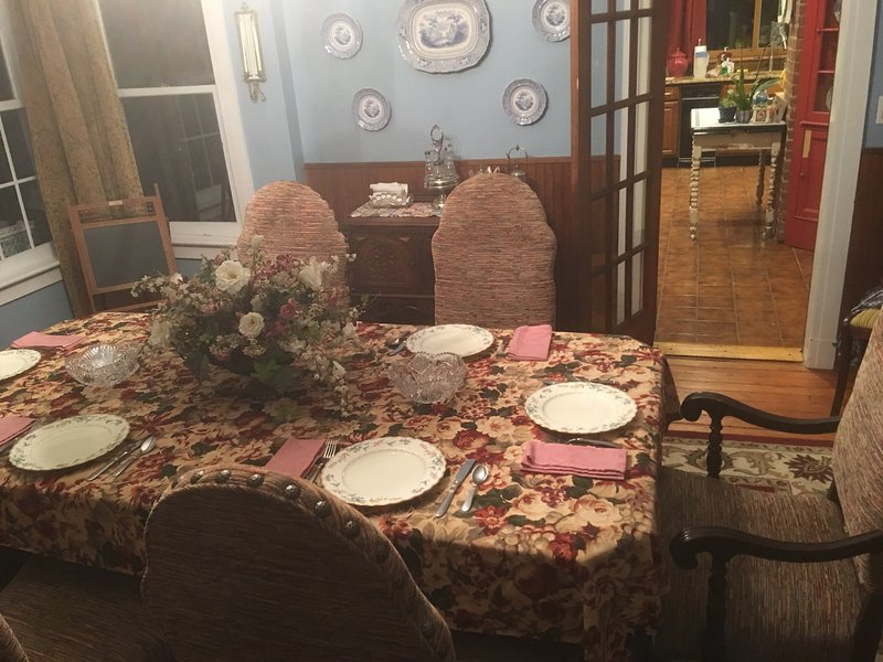 FORMAL DINING ROOM SEATS 10.  FINE CHINA AND GLASSWARE. [Antique Havilland China is an option.]