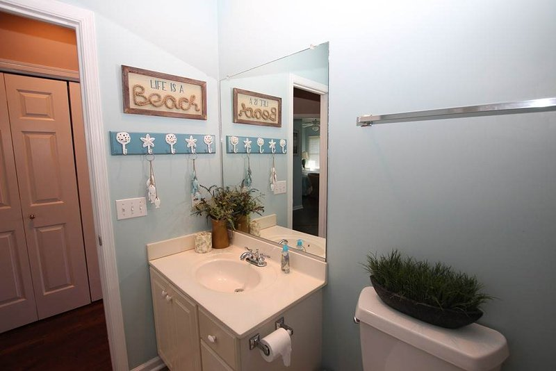 Bathroom,Indoors,Room,Sink,Flower Arrangement