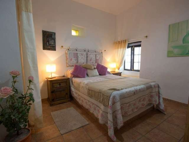 bedroom 2 (with double bed & wardrobe) which overlooks the terrace & pool