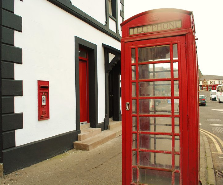 Look out for the red door amongst the red phone box and red postbox