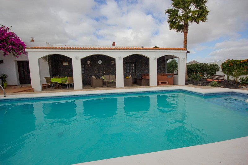 heated pool covered terrace with jacuzzi & rattan suite &dining table & chairs seating 6 people