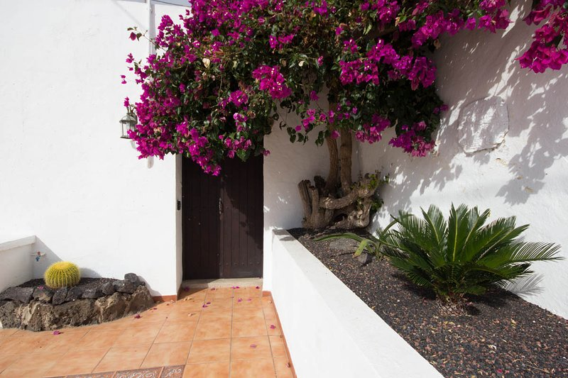 bougainvillea tree enhancing front entrance with double doors into the dining hall