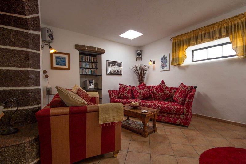 living room with large sofas & walkin inglenook fireplace